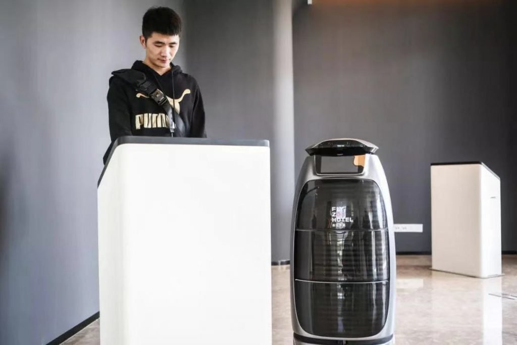 Looking into consumer trends: checking in at Flyzoo Hotel with robot